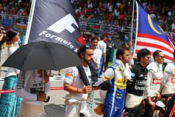 Lewis Hamilton, Mercedes AMG F1 and Fernando Alonso, McLaren as the grid observes the national anthe