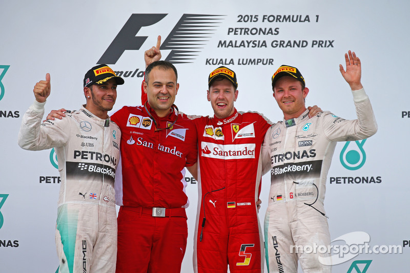 Podium: race winner Sebastian Vettel, Ferrari, second place Lewis Hamilton, Mercedes AMG F1, third place Nico Rosberg, Mercedes AMG F1, Diego Ioverno Ferrari Operations Director