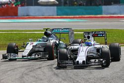 Felipe Massa, Williams FW37 leads Nico Rosberg, Mercedes AMG F1 W06