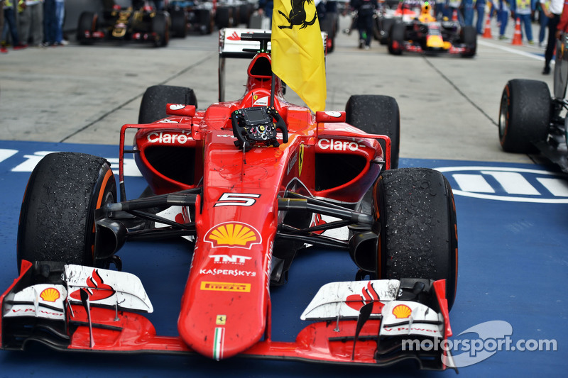 Ferrari SF15-T of race winner Sebastian Vettel, Ferrari in parc ferme