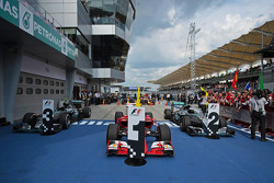 The Ferrari SF15-T of race winner Sebastian Vettel, Ferrari in parc ferme flanked by the Mercedes AMG F1 W06s of Nico Rosberg, Mercedes AMG F1 and Lewis Hamilton, Mercedes AMG F1