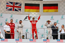The podium, Mercedes AMG F1, second; Sebastian Vettel, Ferrari, race winner; Nico Rosberg, Mercedes AMG F1, third