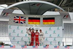 The podium, Mercedes AMG F1, second; Diego Ioverno, Ferrari Operations Director; Sebastian Vettel, Ferrari, race winner; Nico Rosberg, Mercedes AMG F1, third