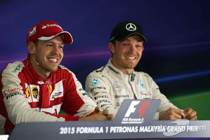 (L to R): Race winner Sebastian Vettel, Ferrari and Nico Rosberg, Mercedes AMG F1 in the FIA Press C
