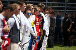 Kimi Raikkonen, Ferrari with the drivers as the grid observes the national anthem