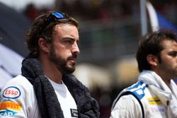 Fernando Alonso, McLaren with the drivers as the grid observes the national anthem