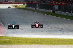 Lewis Hamilton, Mercedes AMG F1 W06 and Sebastian Vettel, Ferrari SF15-T battle for the lead of the race