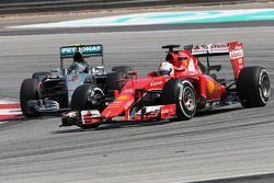Sebastian Vettel, Scuderia Ferrari and Nico Rosberg, Mercedes AMG F1 Team