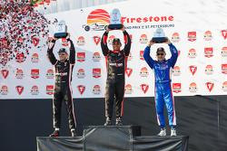 Podium: Second place Will Power, Team Penske Chevrolet, Race winner Juan Pablo Montoya, Team Penske