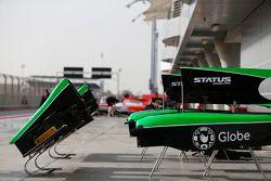 Status Grand Prix bodywork in the pit lane