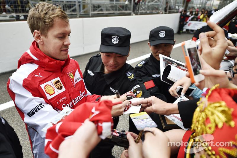 Sebastian Vettel Ferrari signs autographs for the fans