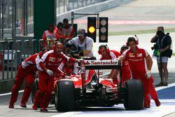 Sebastian Vettel, Ferrari SF15-T is pushed back in the pits