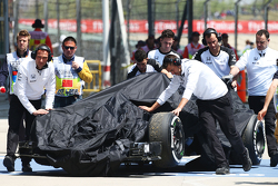 The McLaren MP4-30 of Fernando Alonso, McLaren is recovered back to the pits in the third practice s