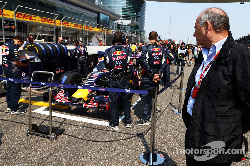 Ron Dennis, McLaren Executive Chairman looks at the Red Bull Racing RB11 on the grid