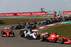 Sebastian Vettel, Ferrari SF15-T leads Valtteri Bottas, Williams FW37 at the start of the race
