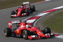 Sebastian Vettel, Ferrari SF15-T leads team mate Kimi Raikkonen, Ferrari SF15-T