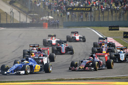 Max Verstappen, Scuderia Toro Rosso STR10 and Marcus Ericsson, Sauber C34 at the start of the race