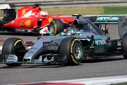 Нико Росберг, Mercedes AMG F1 Team и Себастьян Феттель, Scuderia Ferrari