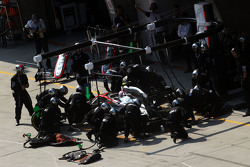 Jenson Button, McLaren MP4-30 makes a pit stop