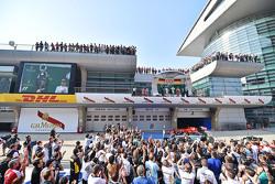The podium: Nico Rosberg Mercedes AMG F1, second; Lewis Hamilton Mercedes AMG F1, race winner; Sebas