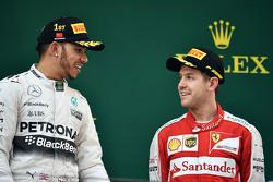 The podium: race winner Lewis Hamilton Mercedes AMG F1 with third placed Sebastian Vettel Ferrari