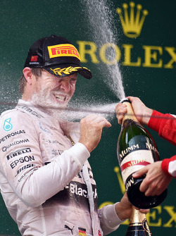 Nico Rosberg Mercedes AMG F1 celebrates his second position with the champagne on the podium