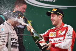The podium: race winner Lewis Hamilton Mercedes AMG F1 and third placed celebrate with the champagne