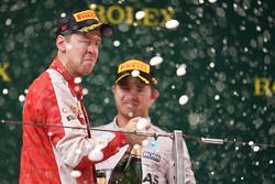 Sebastian Vettel Ferrari celebrates his third position on the podium