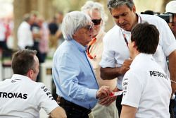 (L to R): Paddy Lowe, Mercedes AMG F1 Executive Director, with Bernie Ecclestone, of the FOM; and Toto Wolff, Mercedes AMG F1 Shareholder and Executive Director