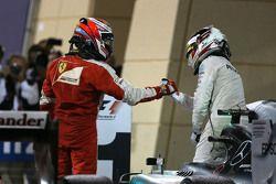 Kimi Raikkonen, Scuderia Ferrari and Lewis Hamilton, Mercedes AMG F1 Team