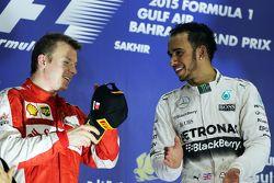 The podium,: second placed Kimi Raikkonen, Ferrari with race winner Lewis Hamilton, Mercedes AMG F1