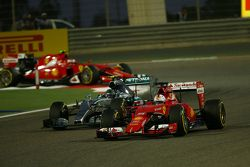 Sebastian Vettel, Ferrari SF15-T leads Nico Rosberg, Mercedes AMG F1 W06