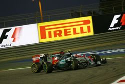 Nico Rosberg, Mercedes AMG F1 W06 and Sebastian Vettel, Ferrari SF15-T battle for position