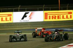 Lewis Hamilton, Mercedes AMG F1 W06 and Kimi Raikkonen, Ferrari SF15-T battle for position