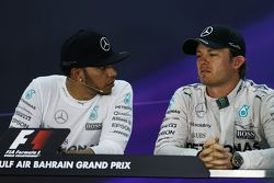 Lewis Hamilton, Mercedes AMG F1 with team mate Nico Rosberg, Mercedes AMG F1 in the FIA Press Confer