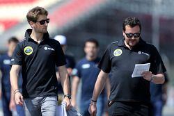 Romain Grosjean, Lotus F1 Team com engenheiro Julien Simon-Chautemps, Lotus F1 Team