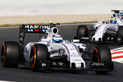 Susie Wolff, Williams FW37 Development Driver leads team mate Felipe Massa, Williams FW38