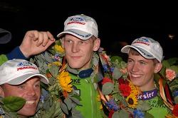 Nic Jonsson, Jorg Bergmeister and Colin Braun celebrate