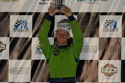 Championship podium: 2006 Grand Am Rolex Series drivers champion Jorg Bergmeister celebrates