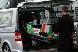Mechanics loads the boat of Christian Abt into a minivan
