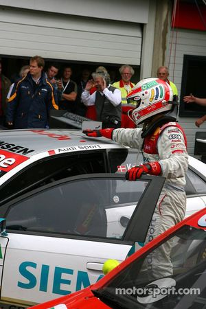 Tom Kristensen pets his car after winning the race