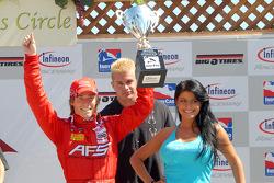 Podium: Alex Lloyd receives trophy from bodybuider Daniel Puter