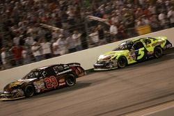 Kevin Harvick leads Kyle Busch