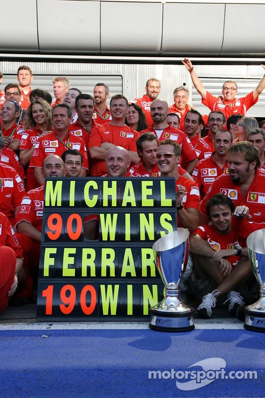 Michael Schumacher celebrates his 90th win and the 190th for Ferrari with Ferrari team members