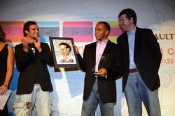 Lewis Hamilton collects a personalised print with his Overtaking Manouvre of the Year Award