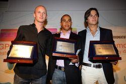 Le troisième Alexandre Premat, le champion Lewis Hamilton le vice-champion Nelson A. Piquet