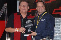 Jay Burchell receives Honorary Starter plaque from Richmond International Raceway president Doug Fri
