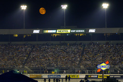 An almost full moon rises over the track