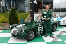 Joe Tierno and trophy with his 1957 MGA