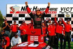 Victory lane: race winner Johnny Benson celebrates